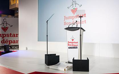 Etymology of Bespoke - podium and stage set-up at Canadian Tire Jumpstart