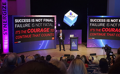 3 Takeaways of Canadian Innovation Conference - man speaking on stage