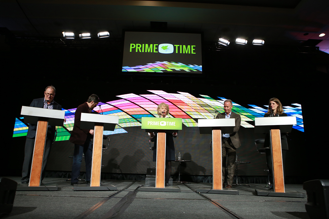 Panelists behind podium at CMPA Prime Time