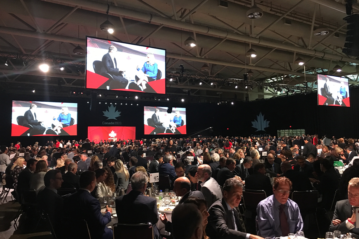 Room full of attendees at Canada 2020 event