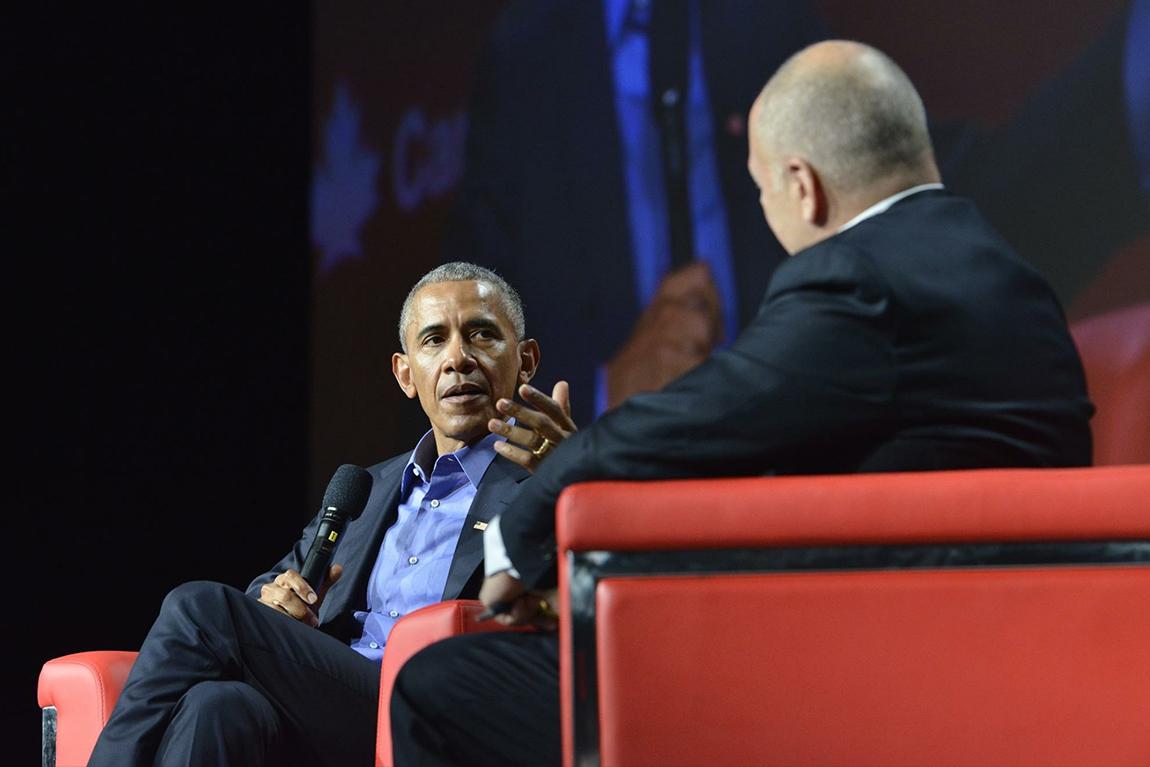 Barack Obama and Bruce Heyman on stage at Canada 2020