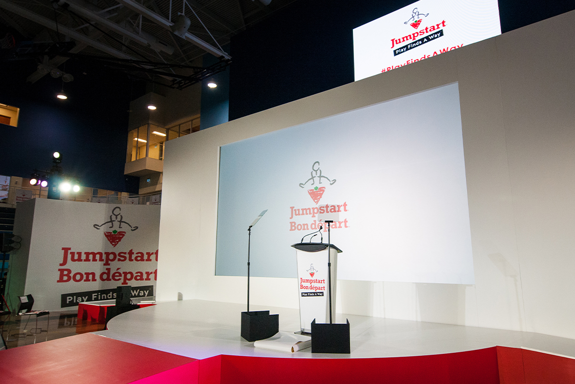 stage set-up with podium at Canadian Tire Jumpstart