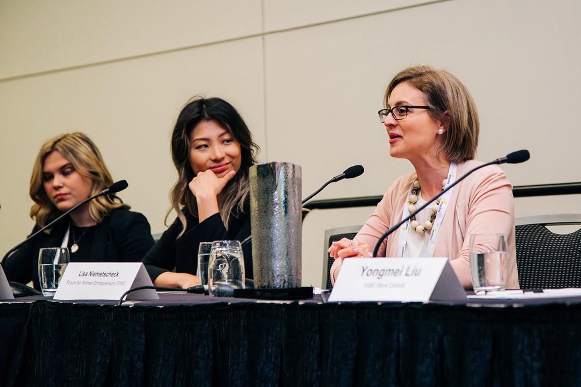 Lisa Niemetscheck speaks at Enactus as panelists look on