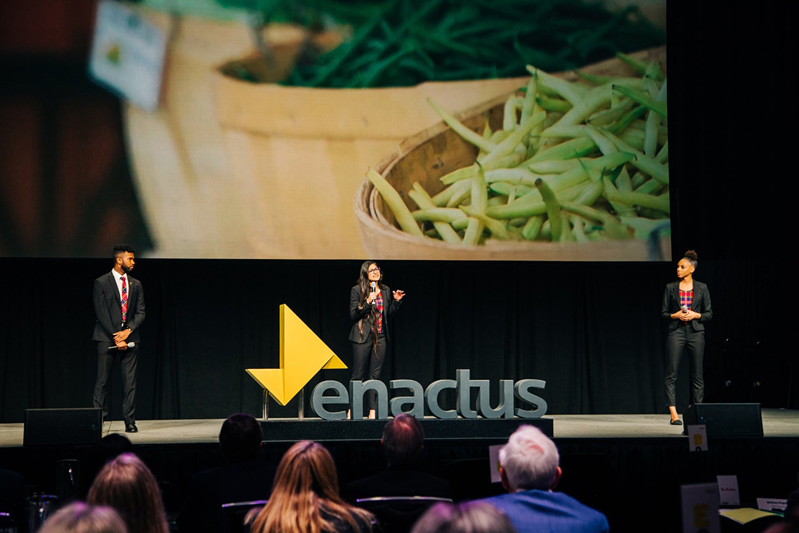 Student team presenting on stage at Enactus Canada