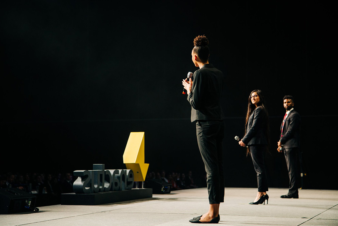Student team presenting pitch on stage at Enactus Canada