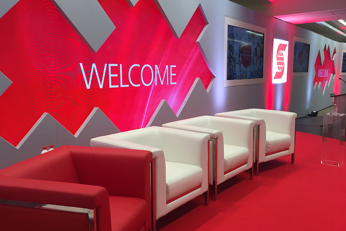 Scotiabank GSLF stage design with chairs and welcome back splash