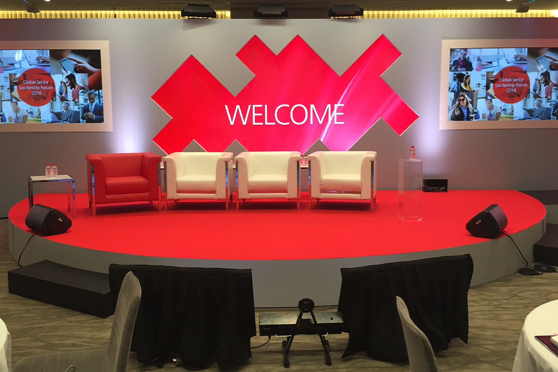 Scotiabank GSLF design - stage with chairs and welcome back splash