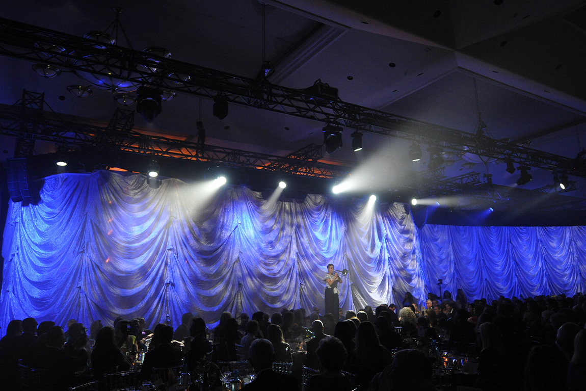 Trombonist performing in front of crowd at TIFF Tribute Gala