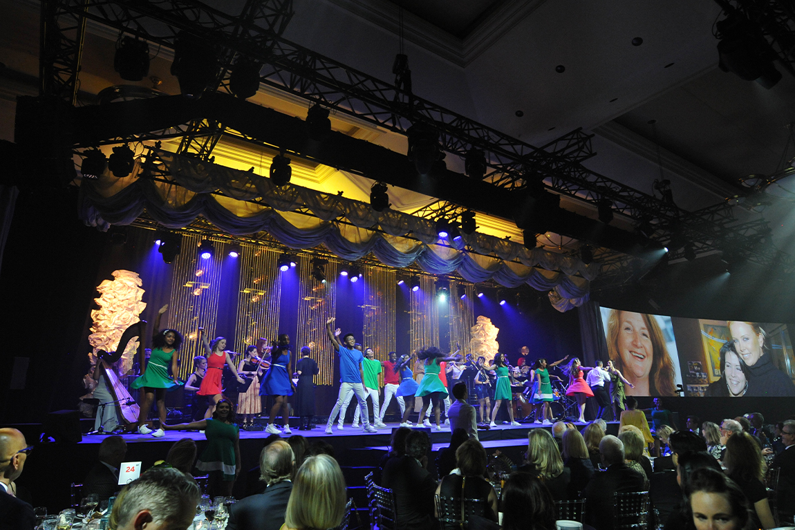 Large group of performers on stage at TIFF Tribute Gala
