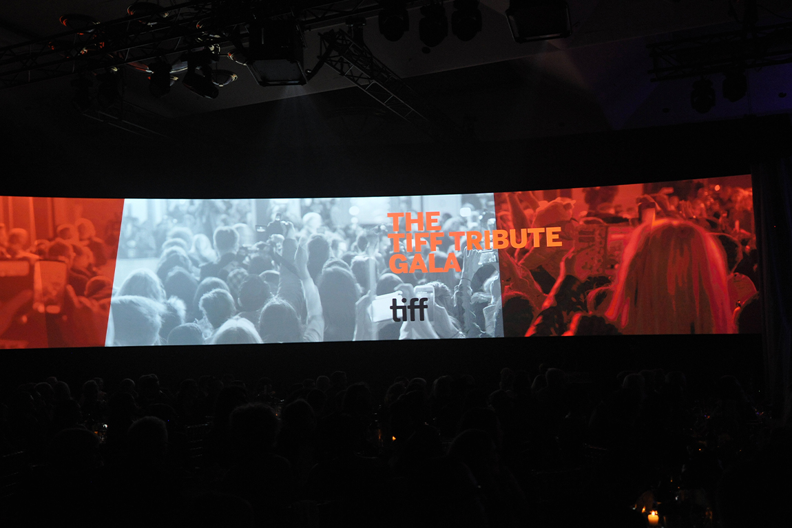 wide media screens on stage at TIFF Tribute Party