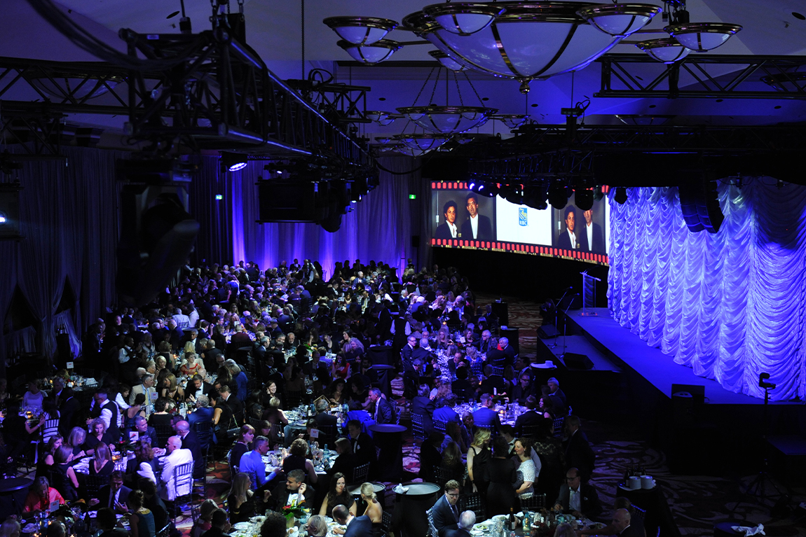 dinner table and stage setup at TIFF Tribute Party