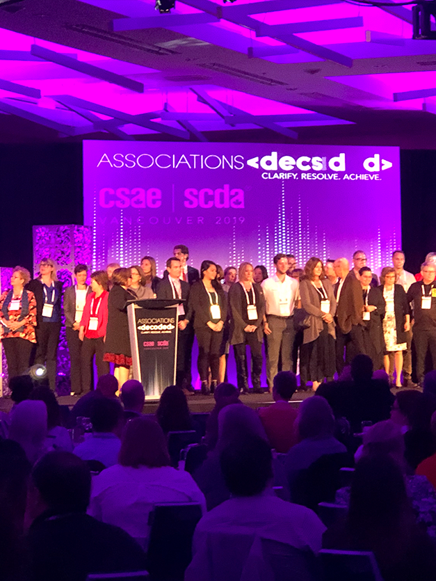 group on stage at CSAE Annual Conference