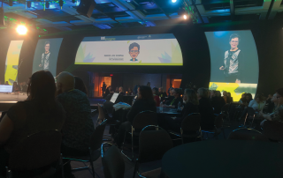 Attendees watch Marie Lou Coupal at Canadian Innovation Conference