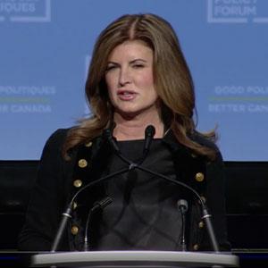 Woman speaking at podium, 2019 Public Policy Forum