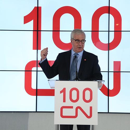 Man speaking at podium, Canadian National Railway 100th Birthday