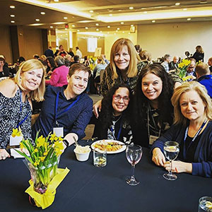 Group smiling at meeting-industry euchre tournament
