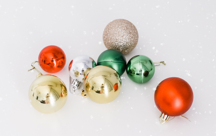red, green, and gold ornaments - hosting a virtual company party
