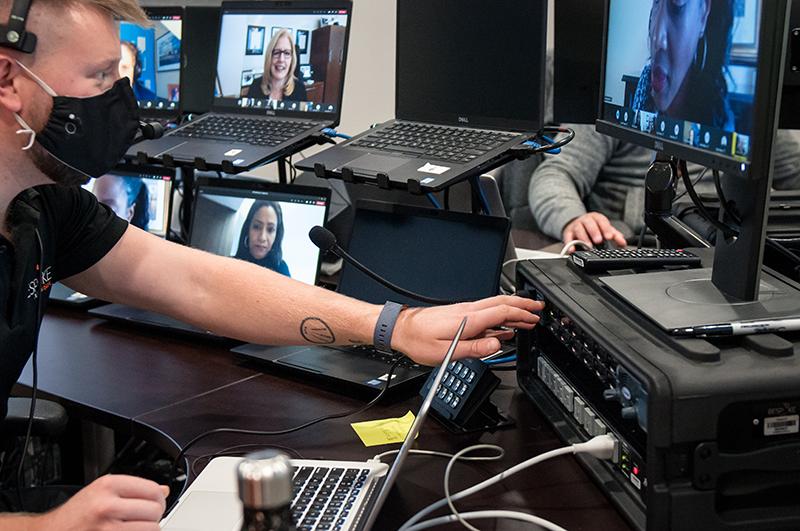 Bespoke AV control room technician at work on multiple monitors