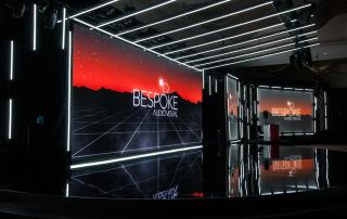 Bespoke AV studio - stage with logo screens in behind